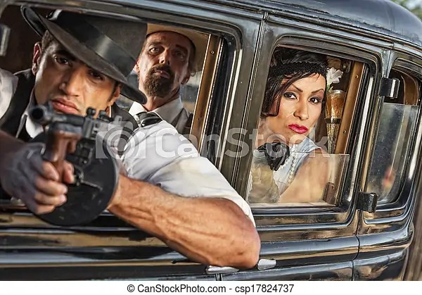 Group of 1920s armed gangsters. Group of three 1920s era gangsters shooting from car window.
