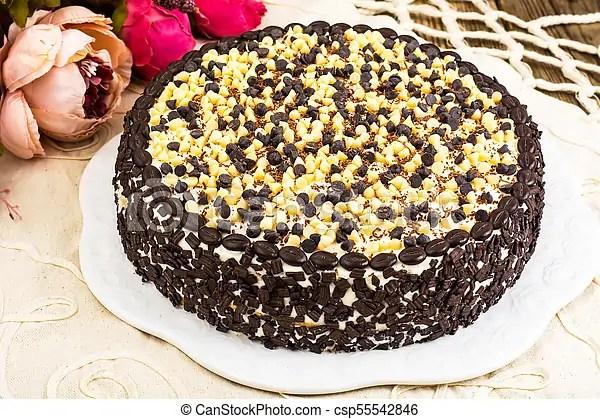 Homemade Cake Decorated With White And Black Chocolate Studio Photo