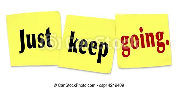 Just keep going determination persistence winning attitude. The words and saying just keep going written on sticky notes to