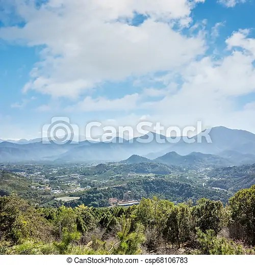 Landscape Of Small Town With Mountain