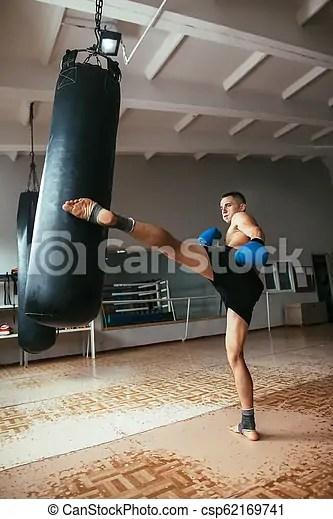 male boxer hitting punching
