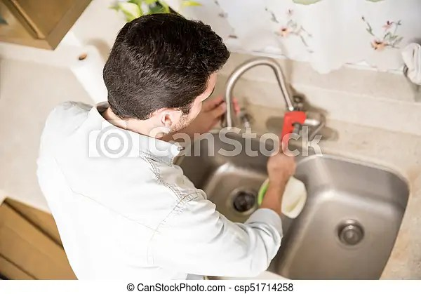https www canstockphoto com man fixing a kitchen faucet 51714258 html