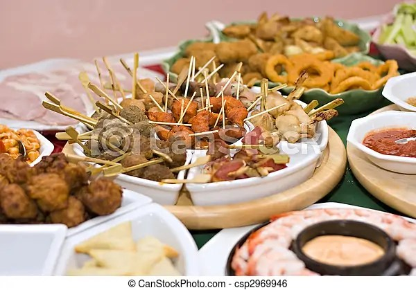Party food A table spread with delicious finger foods