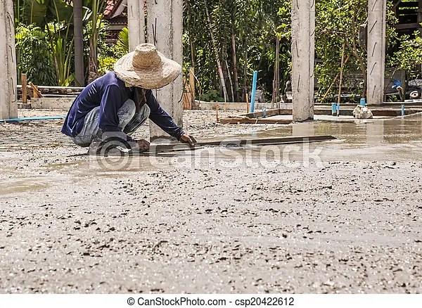 Plasterer concrete worker at floor work.