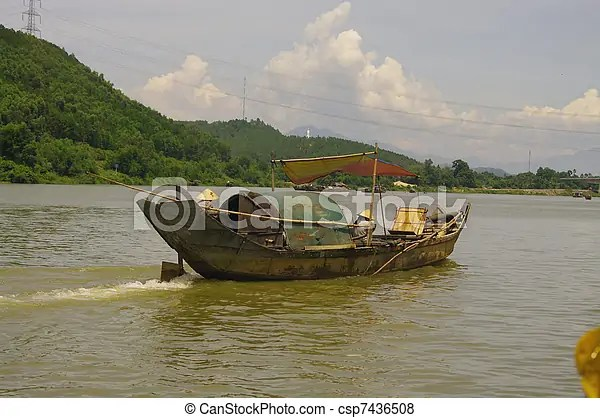 Sampan. There are many sampans on the perfume river. fishing boats and transport. in all cases they are miserable. the families live on the boat.