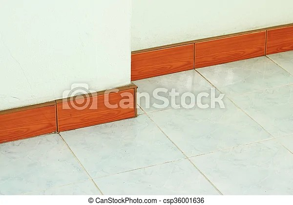 Wooden skirting boards on wall , vintage tone.