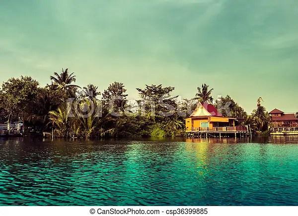 Stilt Houses Above River In Rural Thailand