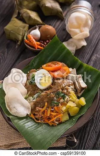 Traditional Indonesian Culinary Food Gado Gado Traditional Indonesian Food Rice Cake Egg And Vegetable With Peanut Sauce Canstock