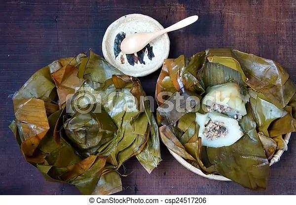 Vietnamese food, pyramid rice dumpling. Vietnamese food, name banh gio: pyramid shaped rice dough dumpling filled with pork, shallot, and wood ear ...