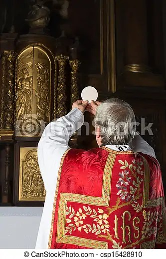 Vintage catholic mass. Consecration during an old-fashioned catholic mass in a 17th century church interior.
