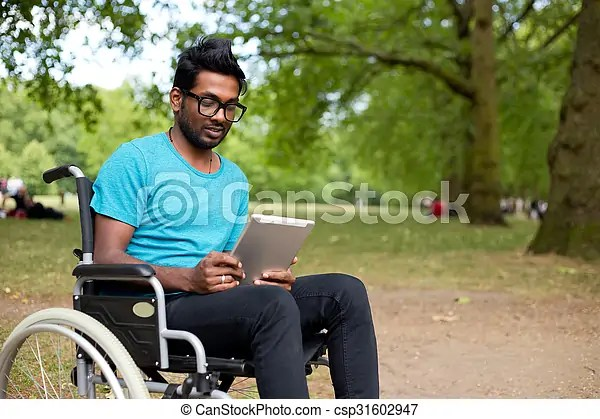 wheelchair man recliner chair sale young indian in a using tablet csp31602947