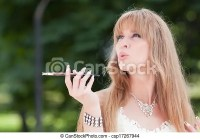 Woman and cigarette holder. Beautiful young woman smoke a ...