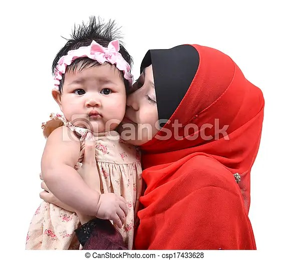 caring muslim mother kissing