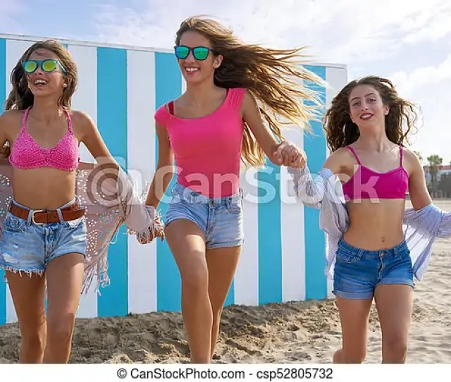 Best Friends Teen Girls Running Happy In Beach Csp52805732