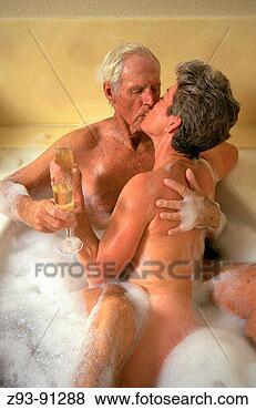 Pictures of Senior couple kiss in bubble bath z9391288