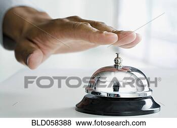Stock Photo - mixed race man ringing service bell. fotosearch - search stock photos, pictures, wall murals, images, and photo clipart
