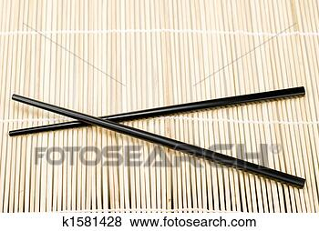 Stock Photo - japanese chop  sticks. fotosearch  - search stock  photos, pictures,  images, and photo  clipart