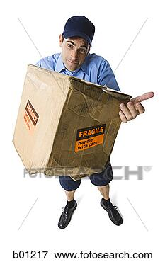 Picture - high angle view of a mailman holding a damaged package. fotosearch - search stock photos, pictures, wall murals, images, and photo clipart