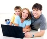 man-woman-and-child-laying-down-looking-at-laptop-screen sydney computer help