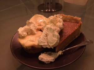 Pumpkin pie and mini cheesecakes with dollops of freshly whipped cream