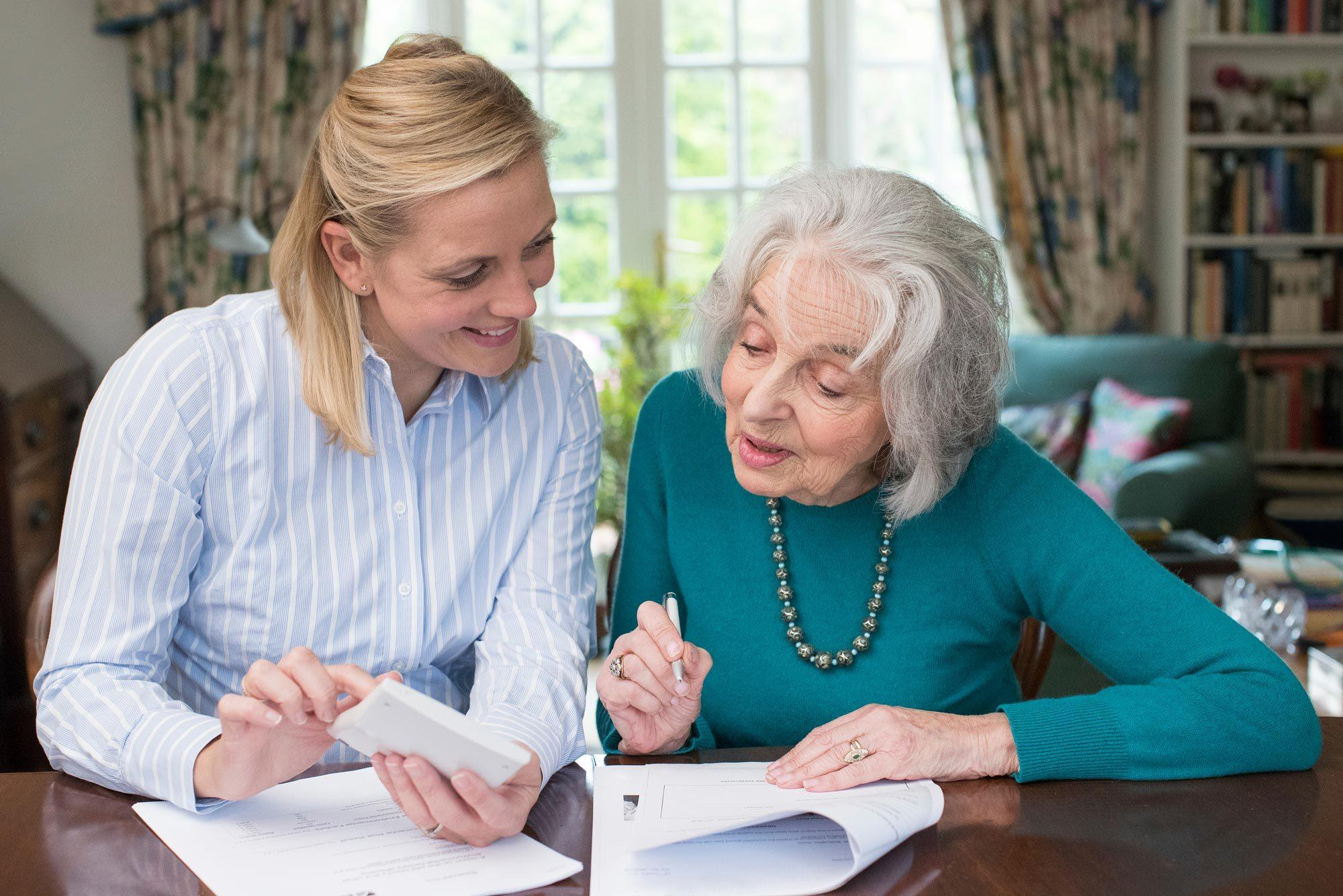 An elderly woman discussing financial power of attorney with her elder law attorney