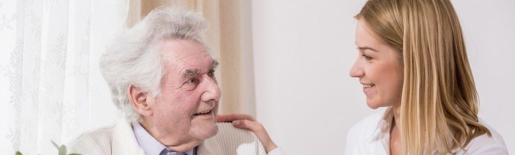 A man talking with his elder care lawyer about guardianship