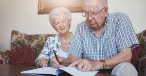 An elderly couple doing research on an elder care attorney