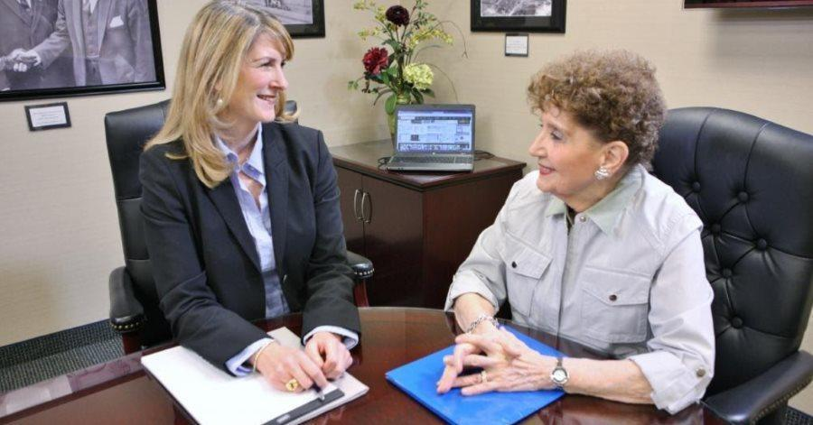 Jennifer Cona speaking with a client about an asset protection trust