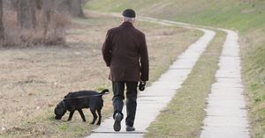 A man walking his dog thinking about Pet Trusts