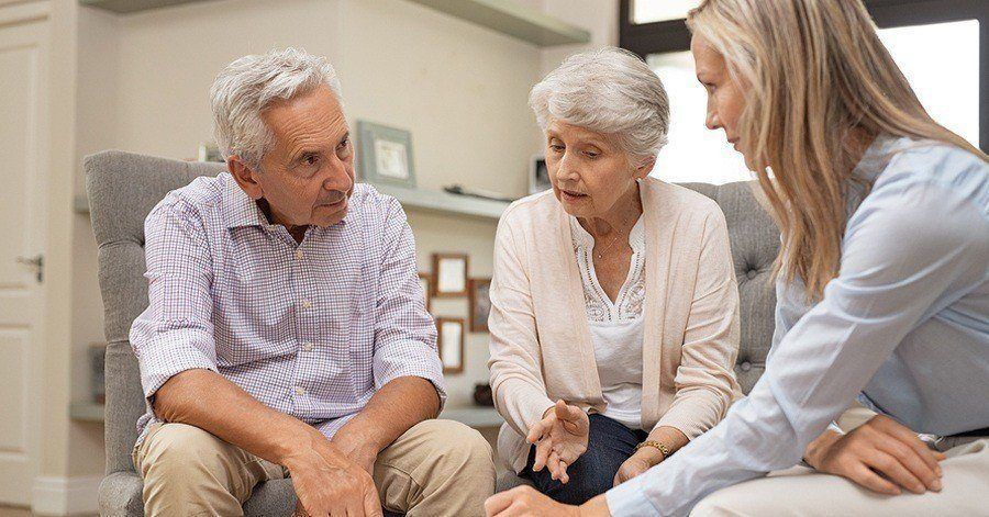 An elderly couple with their attorney discussing estate planning