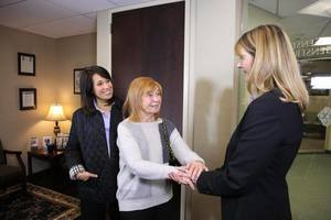 Jennifer Cona greeting people at her elder law attorney open house
