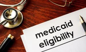 """Piece of paper that says """"Medicaid Eligibility"""""""