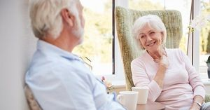 An elderly couple discussing their retirement plans