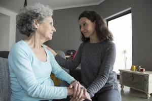 A daughter visiting her mother at an assisted living facility