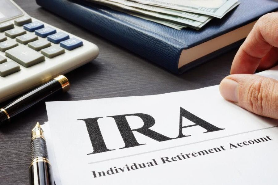 IRA paperwork with a calculator