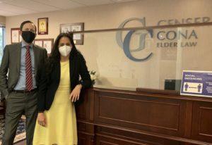 Two Cona Elder Law attorneys wearing masks