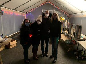 Four people from the Cona Elder Law team serving hot cocoa