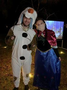 Two in Princess Anna and Olaf costumes from Frozen