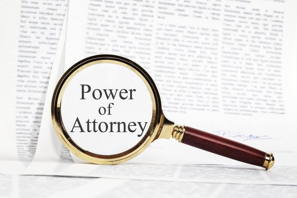 Power of attorney document with a magnify glass