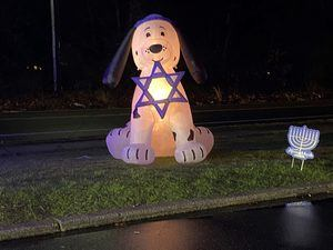 A blow up dog with the Star of David in its mouth
