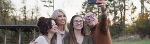 A four person family taking a selfie
