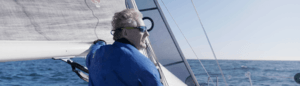 A middle aged man on a sail boat
