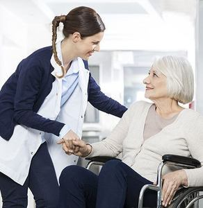 A doctor caring for a patient in a nursing home