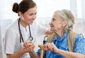 A doctor with her elderly patient
