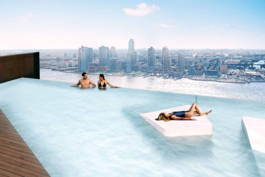 since-the-architects-were-able-to-tuck-away-many-of-the-buildings-mechanical-elements-on-the-bridges-first-floor-they-were-able-to-free-upthe-east-towers-roof-for-a-lavish-infinity-pool