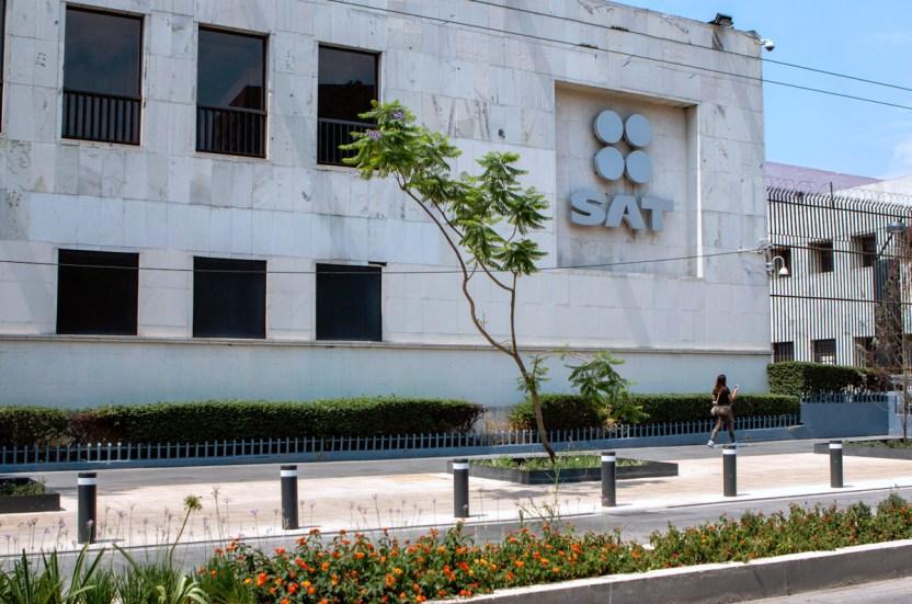 SAT - FEMSA pagará 8 mil 790 mdp al SAT para poner fin a sus diferencias