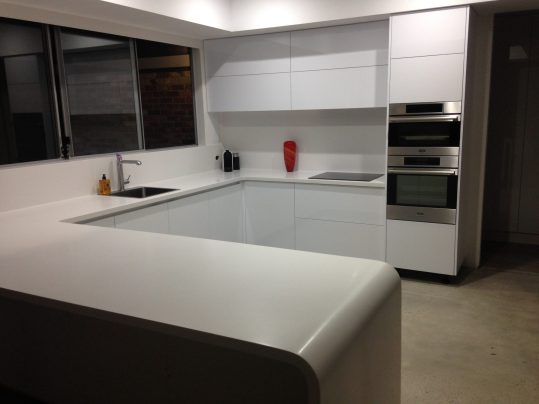 gloss kitchne with thermoform corian top
