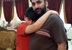 Jahromi hugging his son.