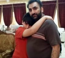 Jahromi hugging his son.