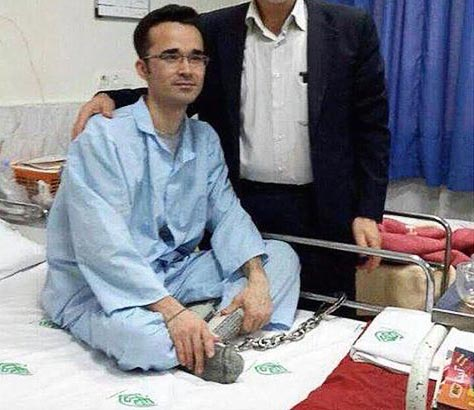 Omid Kokabee chained to a hospital bed before cancer surgery